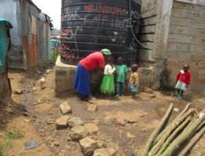 children at water tank
